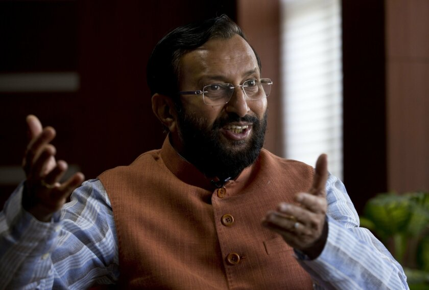 Indian Environment Minister Prakash Javadekar speaks during an interview with an Associated Press correspondent in New Delhi, India, Thursday, Sept. 24, 2015. India will confirm plans next week for a staggering 175 gigawatt growth in its renewable energy portfolio, Javadekar said Thursday. But it will continue to champion poor countries in demanding that industrialized nations assume the brunt of responsibility for decades of climate-warming emissions and help others cope with the consequences. (AP Photo/Saurabh Das)
