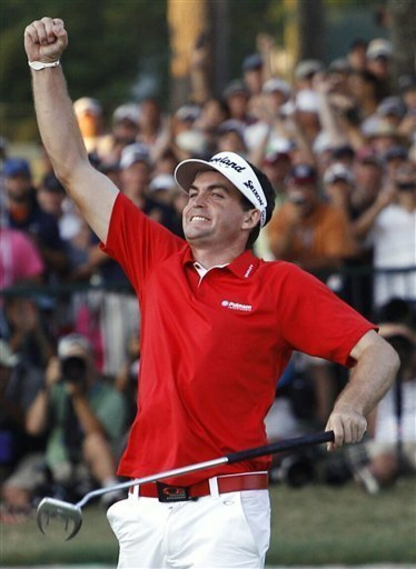 FILE - In this Aug. 14, 2011 file photo, Keegan Bradley celebrates on the 18th green after winning a three-hole playoff against Jason Dufner at the PGA Championship golf tournament in Johns Creek, Ga. Bradley and Tim Clark are the faces in this emerging showdown over the anchored stroke used for long putters. (AP Photo/Matt Slocum, File)
