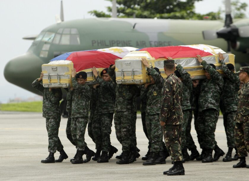Filipino special forces troops carry the flag-draped coffins of fellow service members killed in clashes with Muslim rebels around the southern port city of Zamboanga, where fighting has been flaring for 17 days.