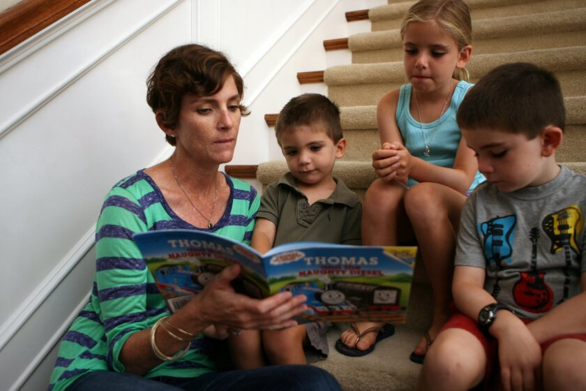 Peggy O'Neil Nosti with her children, from left, Theo, 3, Ella, 8, and Charlie, 5, at their Escondido home on July 29, 2013. photo by Bill Wechter