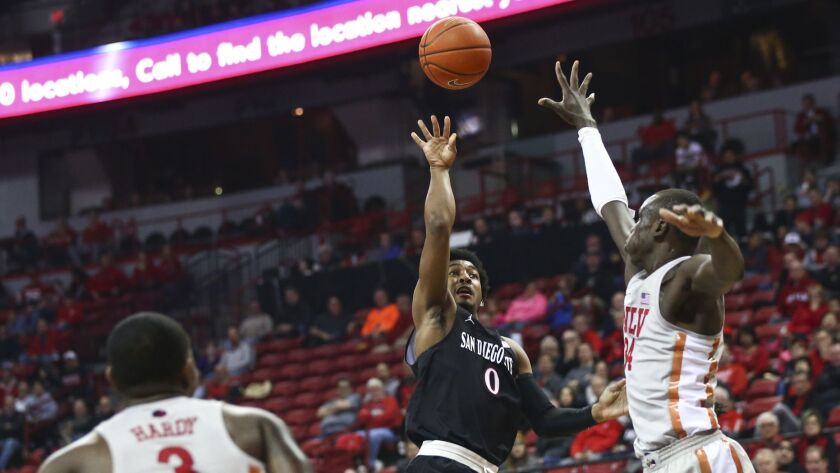 San Diego State Aztecs guard Devin Watson (0) shoots over UNLV Rebels forward Cheikh Mbacke Diong (3