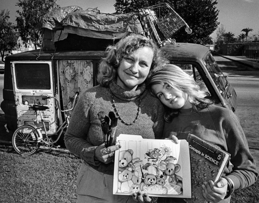 Jan. 12, 1987: Geneva Reesa, 36, and daughter Eve, 13, live in a van. Geneva, an artist, holds her sketchbook. Eve holds a textbook she studies.