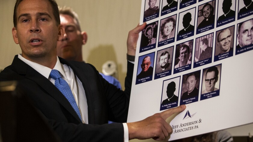 Attorney Mike Reck speaks at a news conference at in Los Angeles on Tuesday. Anderson & Associates announced the filing of a nuisance lawsuit against Roman Catholic dioceses in California.