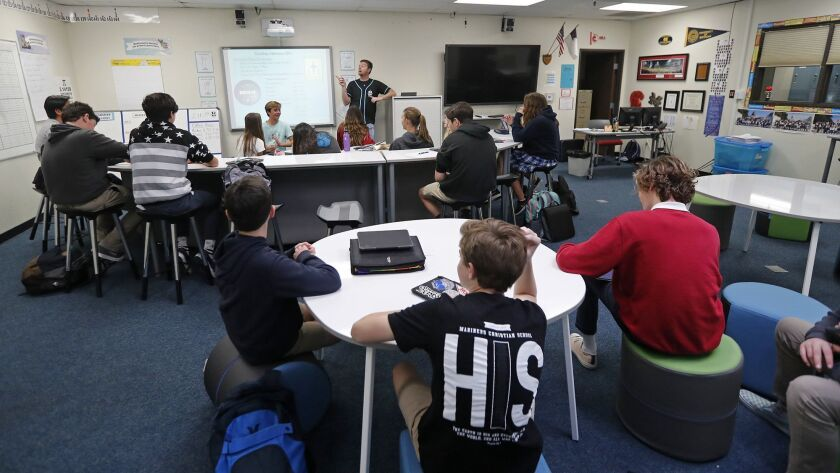 Eighth-graders in math teacher Chris Spurgin's room are among the first to experience furniture that