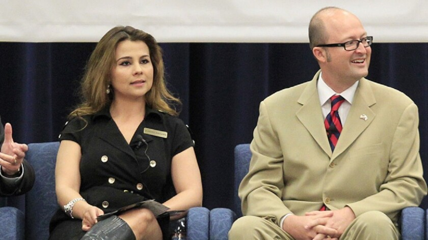 In this file photo, Karina Onofre, left, and Matthew Harper square off during a debate for candidates for the 74th Assembly District in 2014. Harper won the seat that year, but on Tuesday, Onofre finished ahead of Harper in the primary.