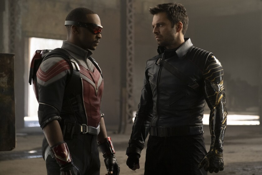 """Two actors in superhero costumes face each other in """"The Falcon and the Winter Soldier"""" on Disney+."""