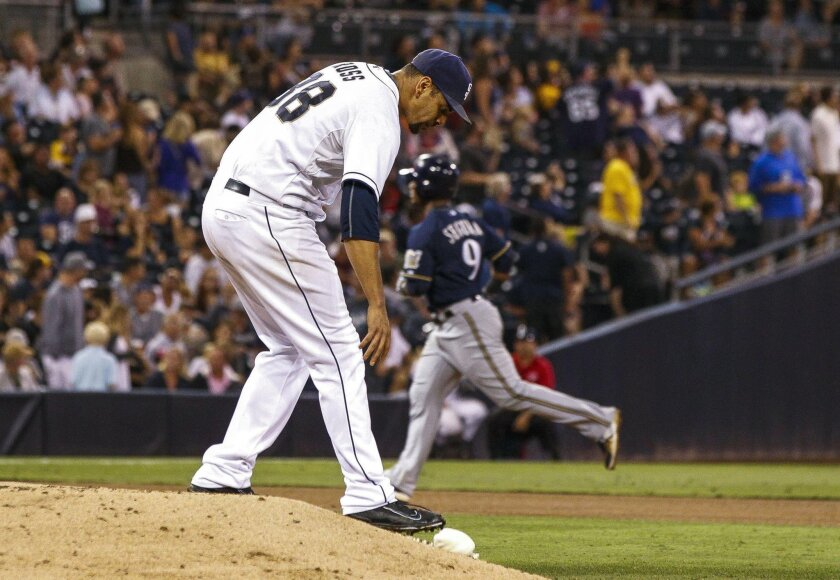 Padres right-hander Tyson Ross bends down for the chalk bag as the Brewers' Jean Segura rounds the bases after he hit a two-run home run in the sixth inning at Petco Park in San Diego on Sept. 29, 2015. Petco Park ranked 10th in the majors in home runs allowed according to ESPN's Park Factors.