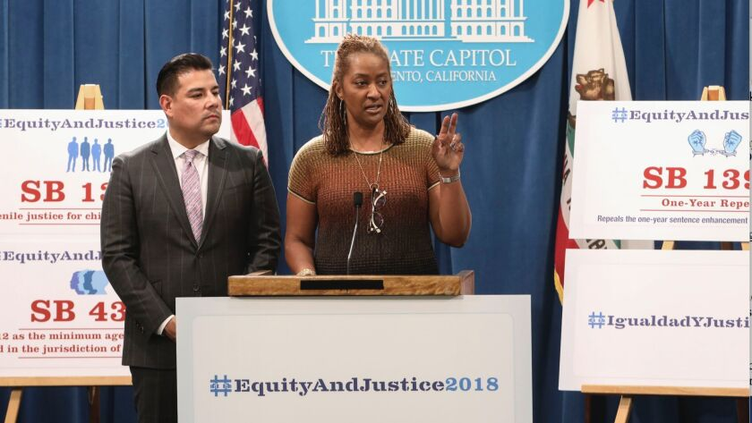 Sens. Ricardo Lara (D-Bell Gardens), left, and Holly J. Mitchell (D-Los Angeles) on Tuesday present