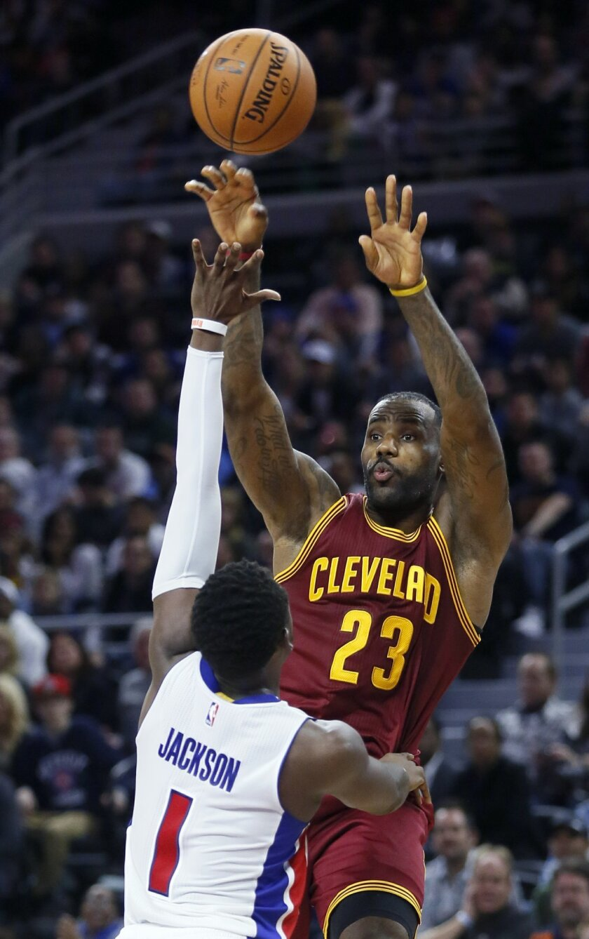 Cleveland Cavaliers' LeBron James (23) passes the ball against Detroit Pistons' Reggie Jackson (1) during the fourth quarter of an NBA basketball game Tuesday, Nov. 17, 2015, in Auburn Hills, Mich. The Pistons defeated the Cavaliers 104-99. (AP Photo/Duane Burleson)