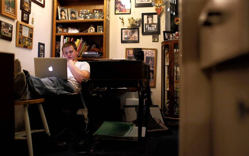 Ryan Field works on homework for a Pierce College remedial math course at his home in Tarzana. Field, who got a B in the course, said the ability to study on his own time was a major plus.