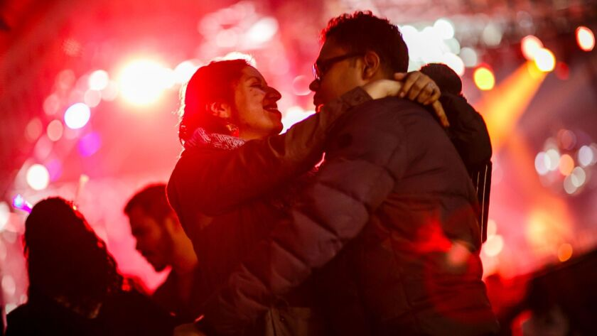 LOS ANGELES, CALIF. -- SUNDAY, DECEMBER 31, 2017: Jessica Rodrigues and Cornelius Rodrigues embrace
