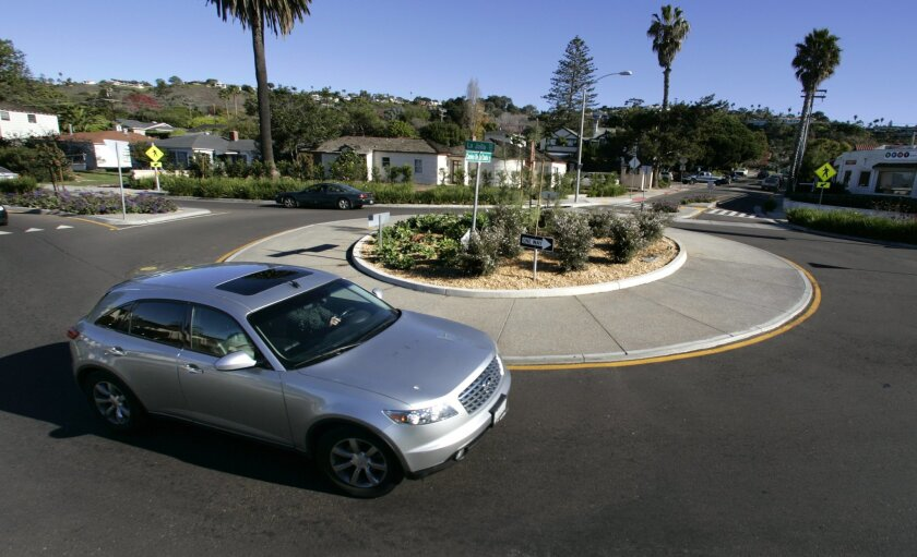 Roundabouts, like this in Bird Rock in 2008, tend to slow traffic and, economists say, improve property values and business.