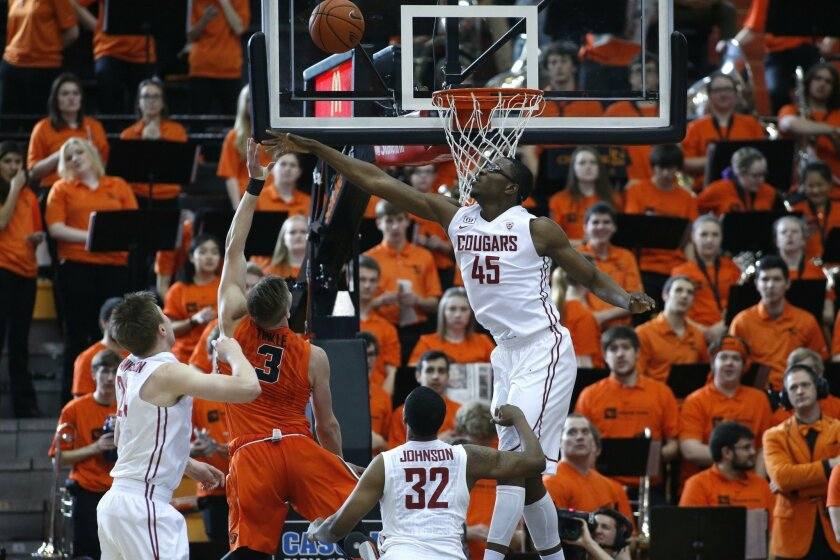 Oregon State's Tres Tinkle (3) and Washington State's Valentine Izundu (45) in the first half of an NCAA college basketball game in Corvallis, Ore., on Sunday, Feb. 28, 2016. (AP Photo/Timothy J. Gonzalez)