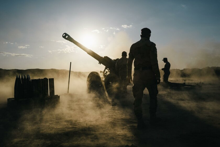 Iraqi soldiers fire artillery towards Islamic State positions from a location outside Makhmour, Iraq. U.S. troops are moving outside the confines of more established bases to give closer support to the Iraqi army as it prepares for an assault on the northern city of Mosul.