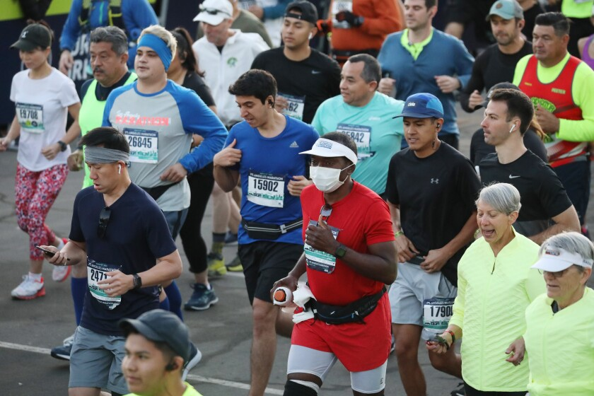 A runner with a mask was among participants at Sunday's L.A. Marathon.