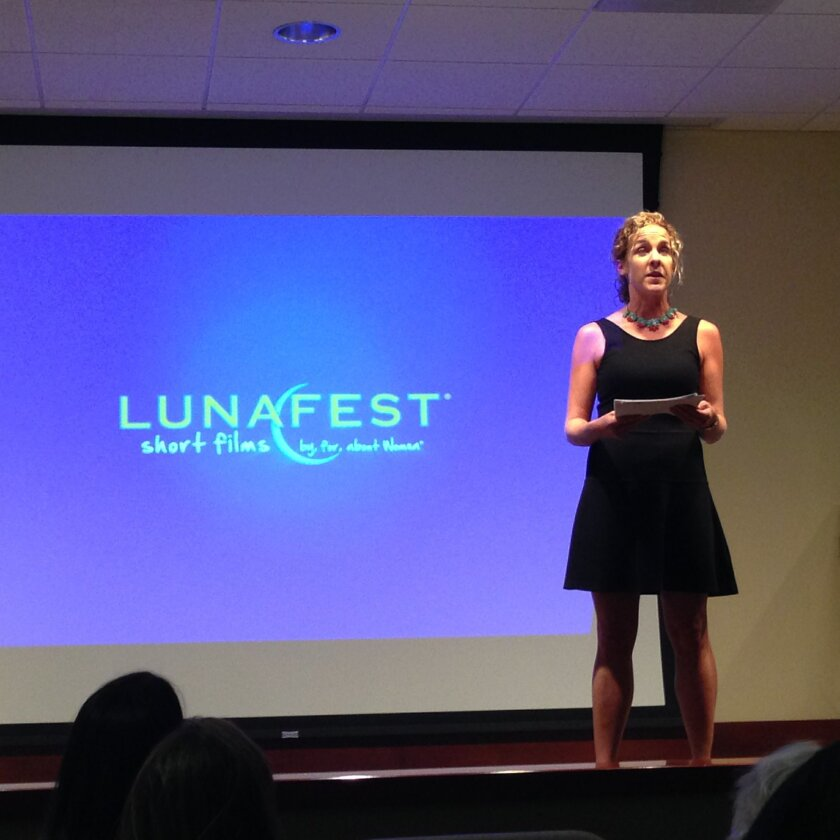 Amy Jerome, executive director of Girls on the Run San Diego, on the stage at Lunafest.