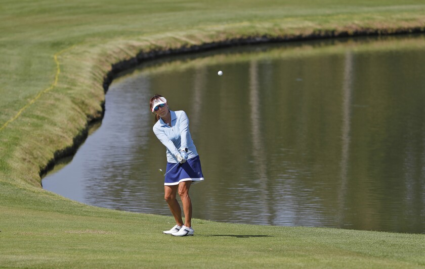Isako Takada from Shady Canyon Golf Club hits the ball from the lakeside during the 21st annual Jones Cup. - Mesa Verde's Kim Izzi Is Dizzy After Sinking Nine Birdies In Jones Cup Win - Los Angeles Times