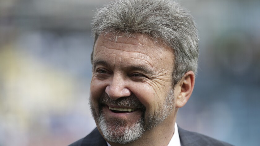 Dodgers General Manager Ned Colletti smiles before a game against the San Francisco Giants in April. Colletti says he wants to sign shortstop Hanley Ramirez to a contract extension.