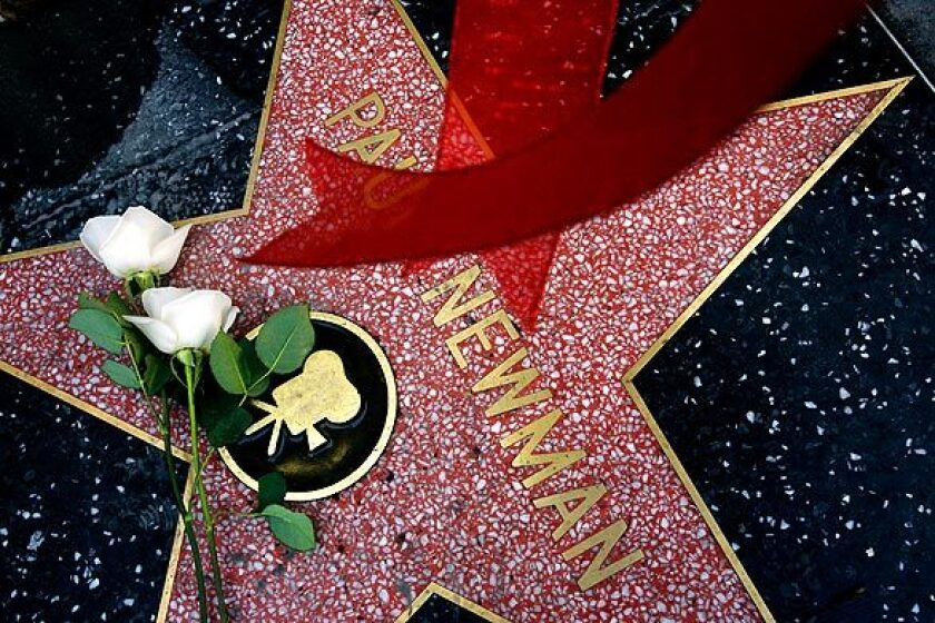 """Flowers were left on the Hollywood star of actor Paul Newman. The legenary star of """"The Hustler,"""" """"Cool Hand Luke"""" and """"Butch Cassidy and the Sundance Kid"""" died of lung cancer at his home in Connecticut."""