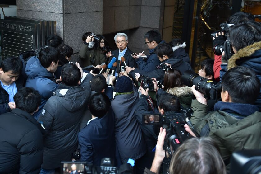 Junichiro Hironaka, the lawyer for former Nissan chairman Carlos Ghosn, fields media questions outside his office in Tokyo.