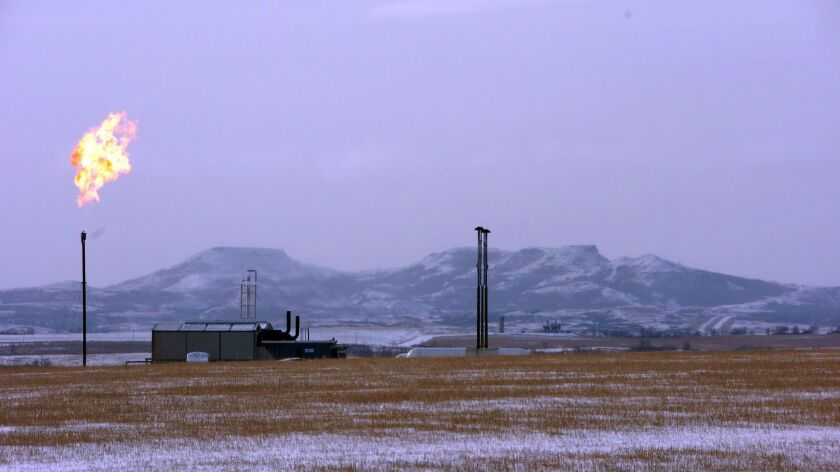 A gas flare at a natural gas processing facility near Williston, N.D.