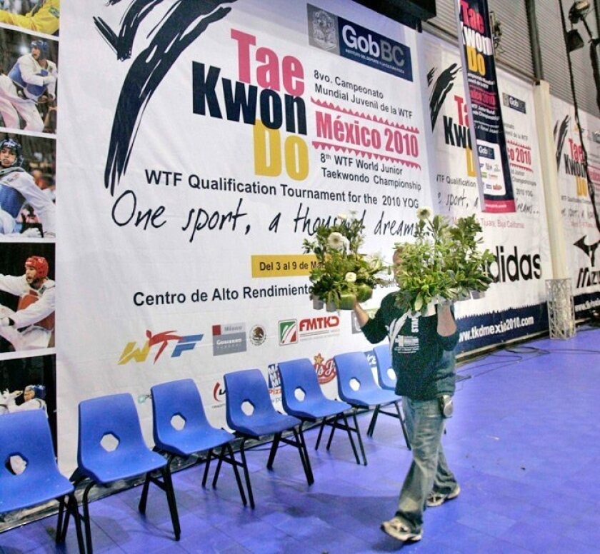 Cesar Ornelas carried flowers that were to be used in the awards ceremony at the World Junior Taekwondo Championships in Tijuana. According to tourism officials, the city hosted 10,000 athletes for a series of competitions last year that pumped $2.5 million into its economy. Tourism has lagged because of the global recession and drug violence in Mexico.