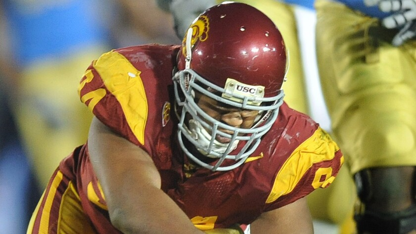 USC defensive lineman Armond Armstead sacks UCLA quarterback Richard Brehaut during a game at the Rose Bowl in December 2010.