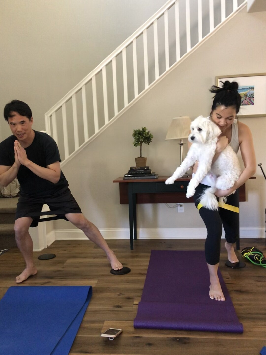 Charles Yu exercising with his wife, Michelle, and their dog.