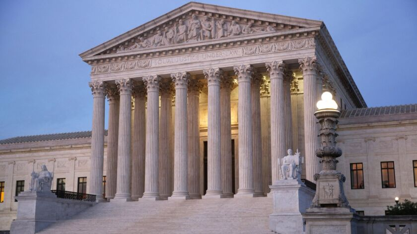In this May 23, 2019 photo, the U.S. Supreme Court building at dusk on Capitol Hill in Washington. (