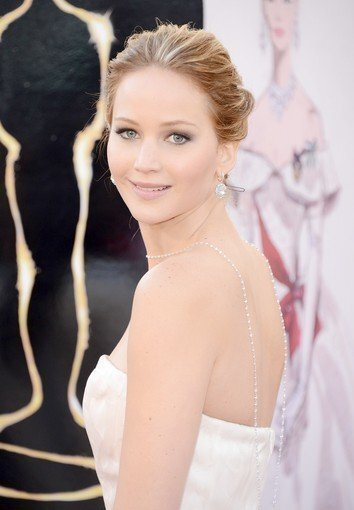 Jennifer Lawrence wore 74 carats of Chopard diamond beads dripping down her back. That and her Lucite and crystal Roger Vivier Boite de Nuit clutch added interest to her classic pale-pink Dior Couture ball gown.