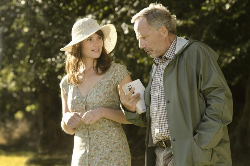 "Gemma Arterton and Fabrice Luchini in the movie ""Gemma Bovery."""