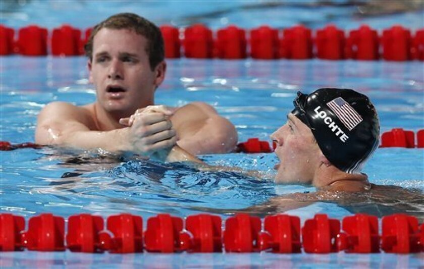 Gold medalist United States's Ryan Lochte, right, is congratulated by Tyler Clary of the United States, bronze, after the Men's 200m backstroke final at the FINA Swimming World Championships in Barcelona, Spain, Friday, Aug. 2, 2013. (AP Photo/Daniel Ochoa de Olza)