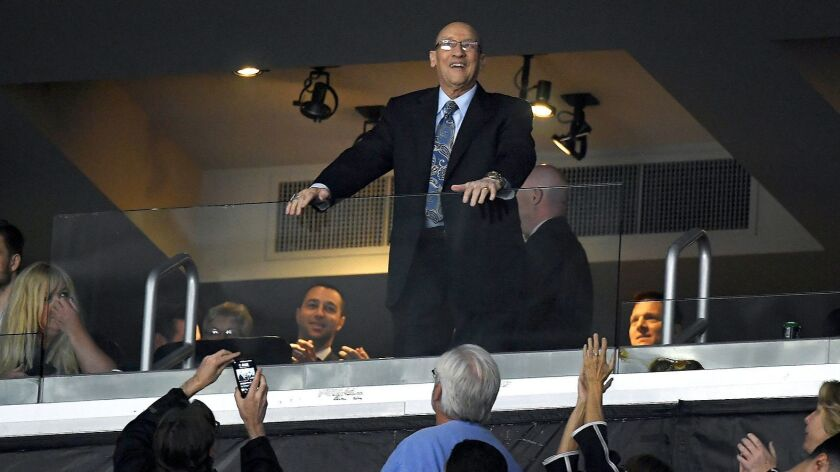 Los Angeles Kings announcer Bob Miller acknowledges fans during the first period of a game on March