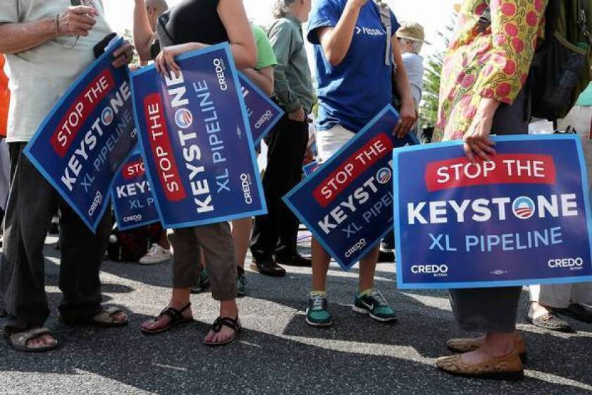 Activists in Washington protest the proposed Keystone XL pipeline. An Interior Department letter warns the project could have lasting, harmful effects on wildlife along its route.