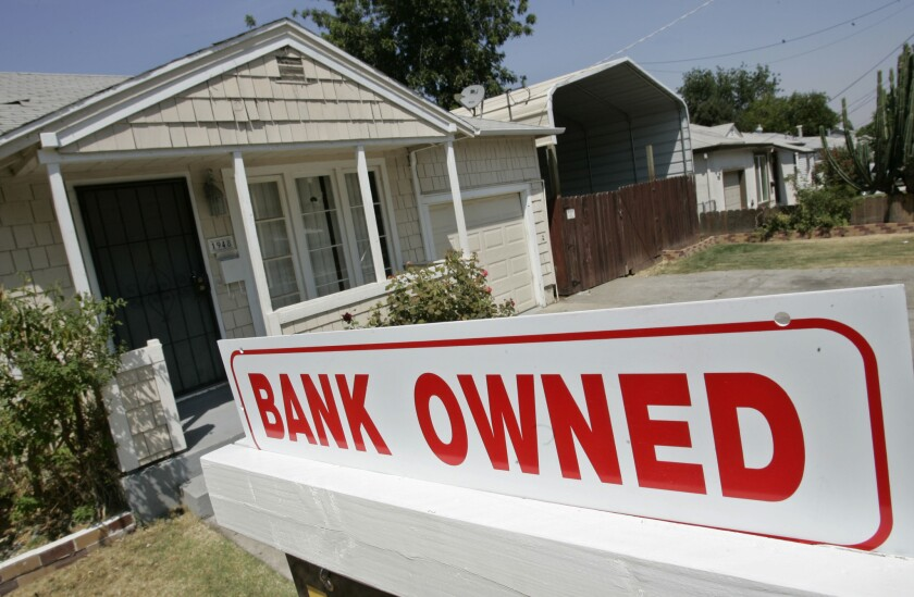 A house under foreclosure in Antioch, Calif., in 2007. Some homeowners are able to delay mortgage payments for now as the economy freezes up, but it's unclear if that will hold off another wave of foreclosures.