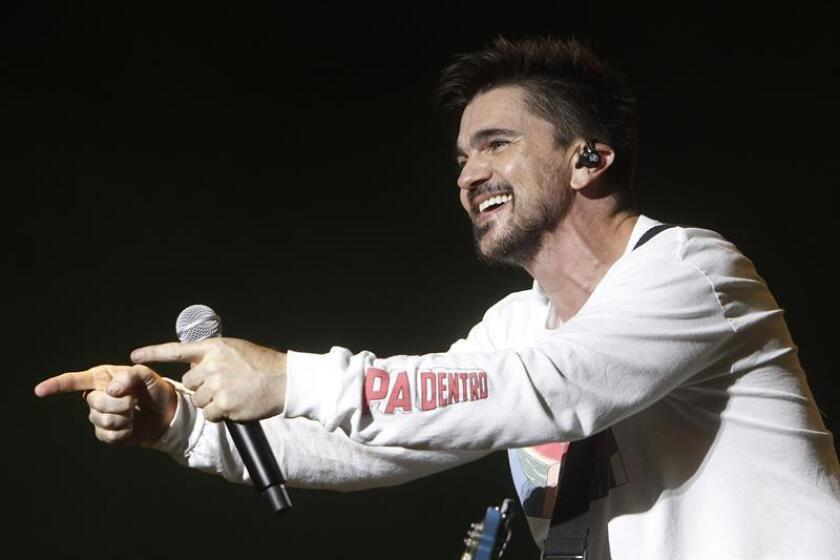 El cantante colombiano Juanes durante una presentación. EFE/Archivo