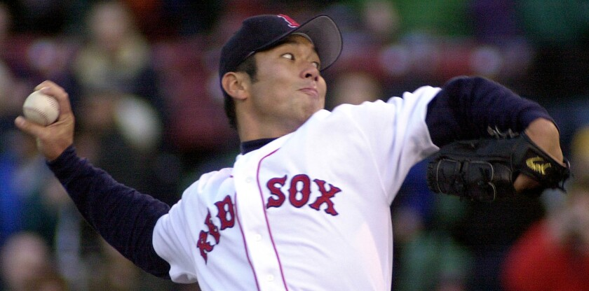 Hideo Nomo of the Boston Red Sox gets ready to deliver a pitch in 2001.
