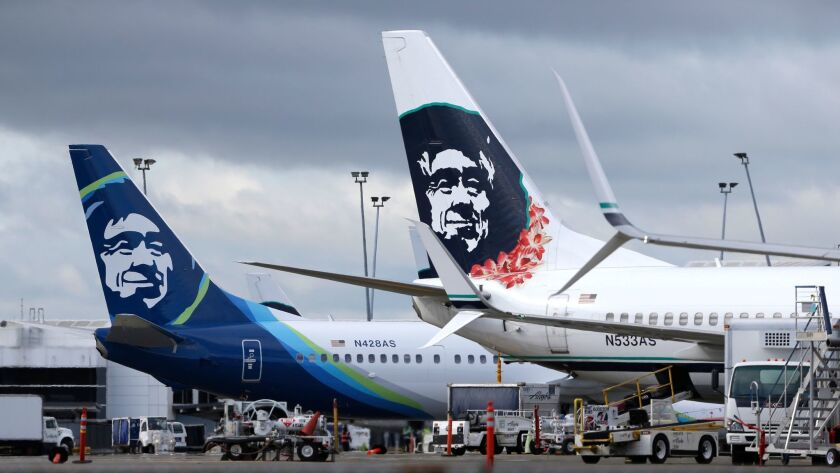 FILE - In this Monday, April 4, 2016, file photo, Alaska Airlines planes are shown parked at Seattle-Tacoma International Airport in Seattle.