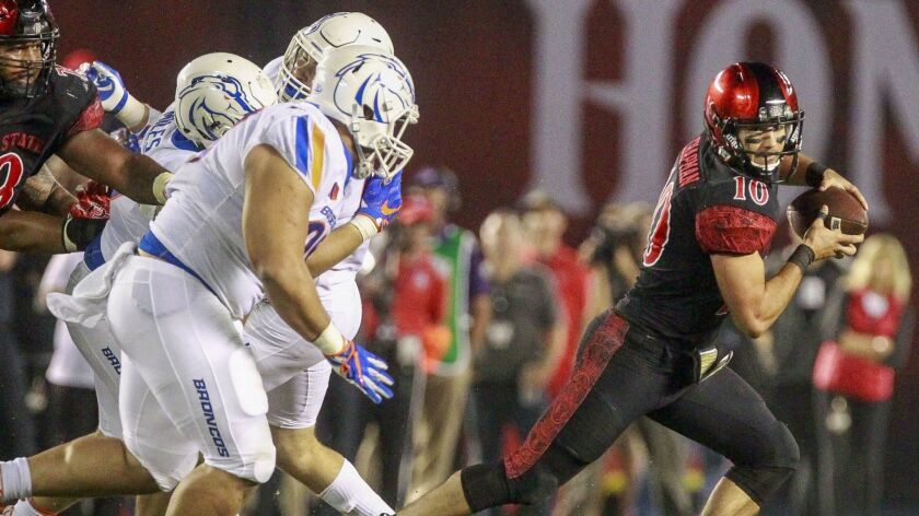 San Diego State quarterback Christian Chapman scrambles during the Aztecs' game last year against Boise State at SDCCU Stadium. The teams meet this year on Oct. 6 in Boise, Idaho.