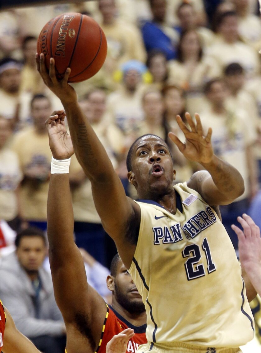 Pittsburgh's Lamar Patterson (21) shoots past Maryland's Shaquille Cleare in the first half of an NCAA college basketball game on Monday, Jan. 6, 2014, in Pittsburgh. (AP Photo/Keith Srakocic)