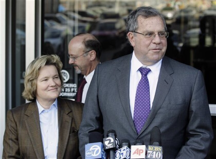 Cris Arguedas, Ted Cassman, and Allen Ruby, from left, attorneys for Barry Bonds, talk to reporters outside the federal courthouse after the first day of Bonds' perjury trial in San Francisco, Monday, March 21, 2011. (AP Photo/Jeff Chiu)