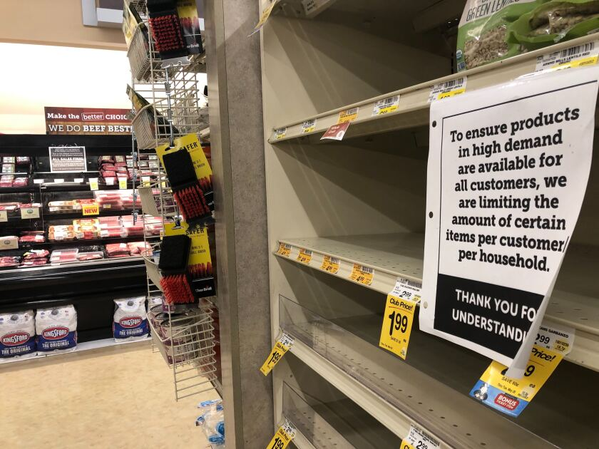 A sign informs customers that some groceries were limited by household at a Vons in Los Feliz in April