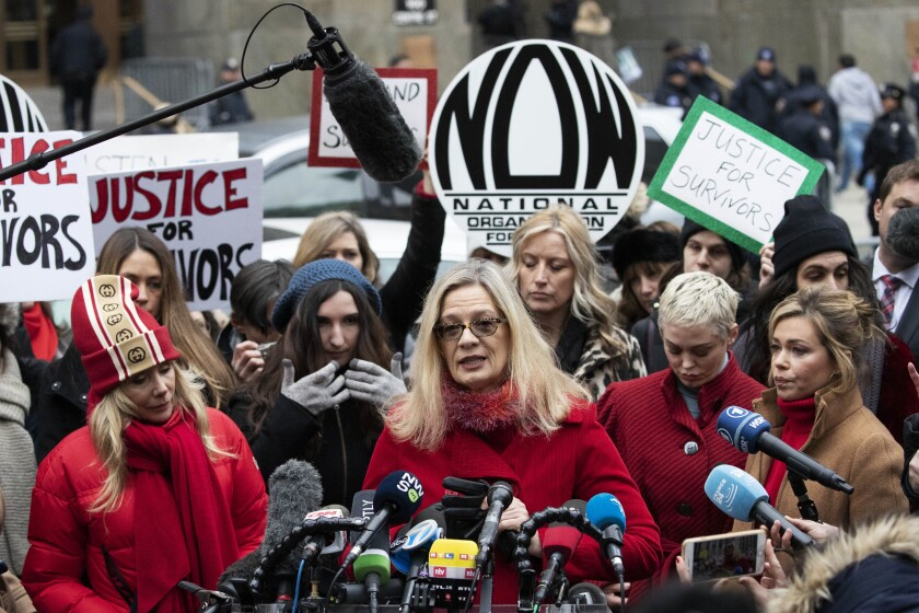 """FILE - In this Jan. 6, 2020, file photo, Louise Godbold, center, speaks at a news conference outside a Manhattan courthouse after Harvey Weinstein arrived in New York. Godbold, who said that Weinstein sexually assaulted her after she sought an internship in 1991, isn't sure that justice is yet available in the court system. """"But, in a global sense, justice to me is that his power and influence is taken away,"""" Godbold said. (AP Photo/Mark Lennihan, File)"""