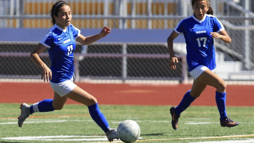 San Diego High School's Valeria Vargas, left, brings up the ball with her teammate and sister Vivian