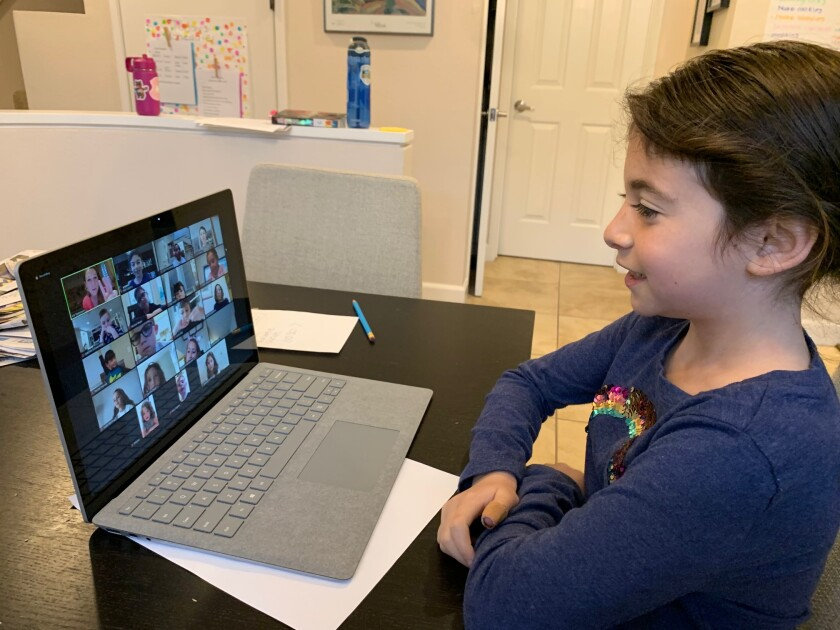 A SDJA student participates in a whole-class session from home.
