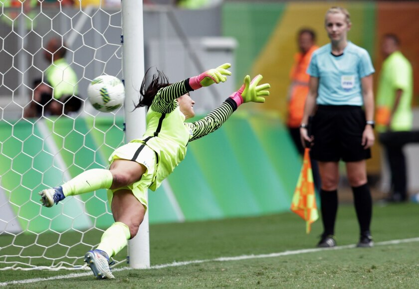 United States goalkeeper Hope Solo fails to stop a penalty during a penalty shoot-out in the quarter-final match of the women's Olympic football tournament between the United States and Sweden in Brasilia Friday Aug. 12, 2016. The United States was eliminated by Sweden after a penalty shoot-out.(AP