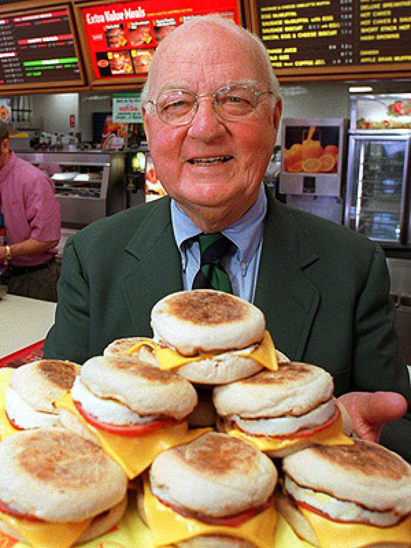 Herb Peterson, the creator of the Egg McMuffin, shows off his invention in this April 1997 file photo, at one of his McDonald's franchises in Santa Barbara, Calif.