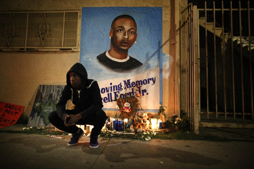 A mourner outside a memorial for Ezell Ford several months after he was fatally shot by LAPD officers near his South L.A. home in August 2014.
