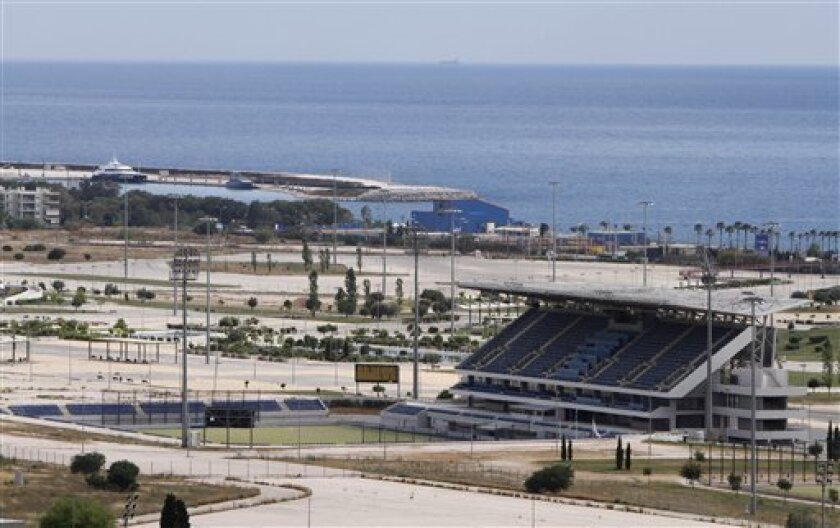In this photo taken on May 18, 2010, a vacant field hockey arena stands at a seaside Olympic complex near Athens. Olympic officials deny that massive spending for the 2004 Games in Athens contributed to the country's financial crisis. (AP Photo/Petros Giannakouris)