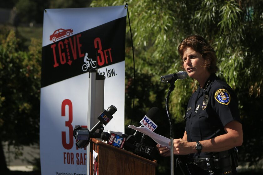 San Diego Police Chief Shelley Zimmerman and other state and local officials announced Tuesday a new bike law requiring motorists to keep three feet between their cars and bicycles while passing officially went into effect.